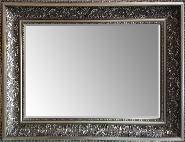 Mirror with silver frame.